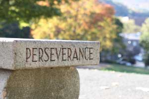 Photo of a inscription on stone that says Perseverance